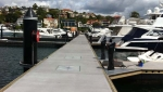 The concrete floating docks at the two marinas are finished with a raven color