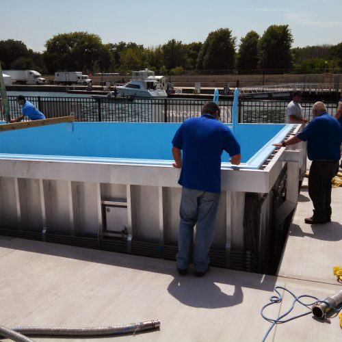 Installation of the aluminum pool insert.