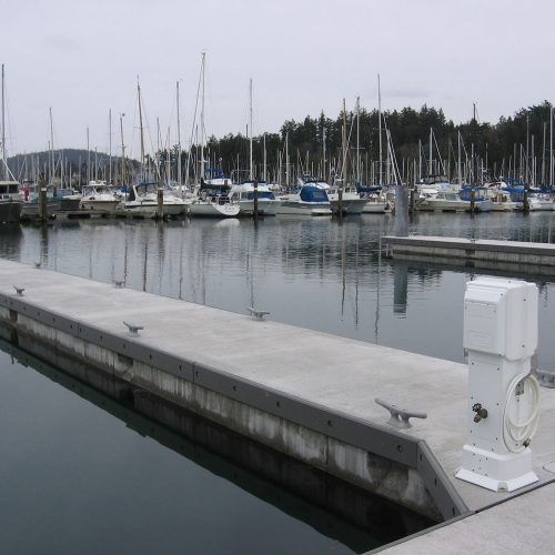 Composite rub boards on Unibolt concrete floating dock.