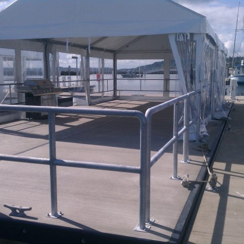 Portable activity floating platform. The platform may be tied up in any open berth and rented out for events.