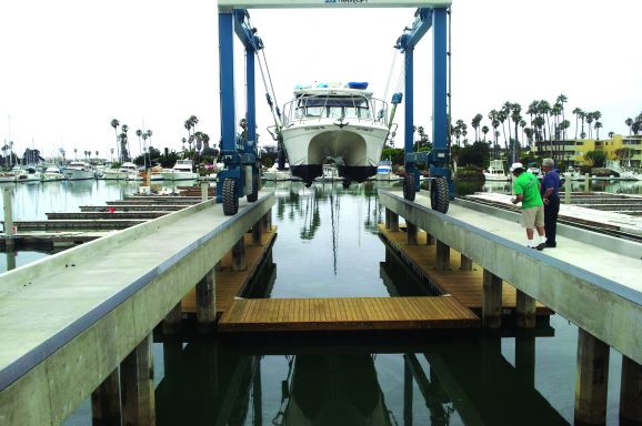 Timber service docks under fixed travel-lift pier.