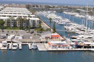 Floating platforms can be home to numerous amenities. At Marina del Rey in California, a floating platform supports a store and bait pens.