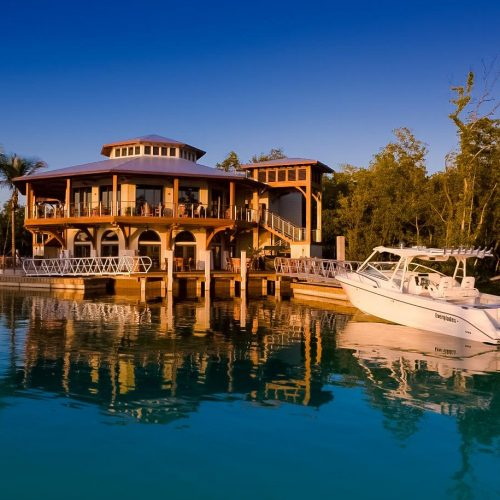 The high-end yacht club features a stunning clubhouse and restaurant with sweeping views of the marina and surrounding mangroves.