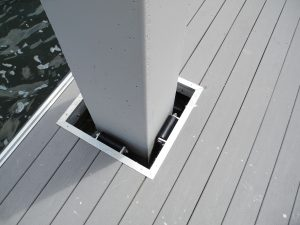 Internal pile guide on aluminum dock