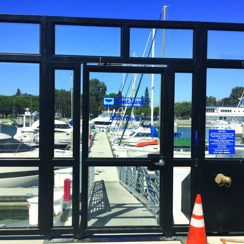 The marina is secured with a custom glass entry gate.