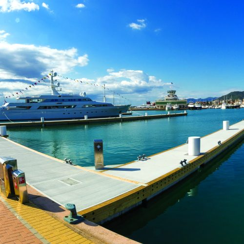 Long curved walkway next to the superyacht moorage.
