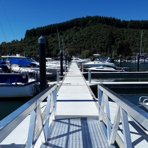Custom gangway and Unifloat concrete floating docks