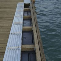 Flip-up utility raceway on portable dock