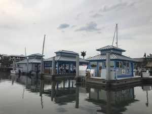 A brightly painted dockmaster's office, restroom/laundry facility and a large gazebo each site on match-cast floating platforms by Bellingham Marine.