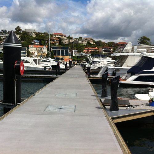 Stainless mega-bollards and charcoal colored pontoons.