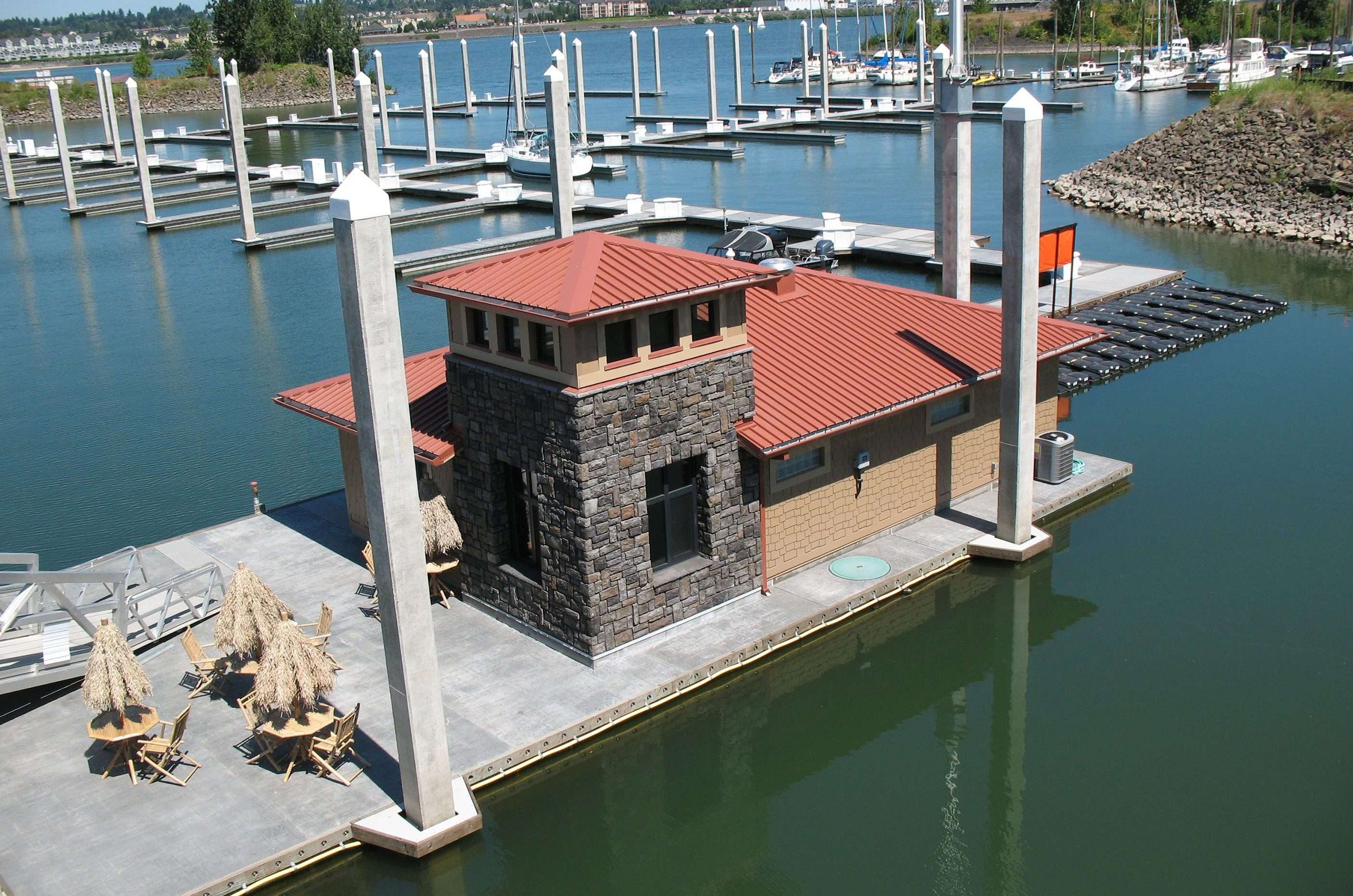 Floating building platform with stamped concrete